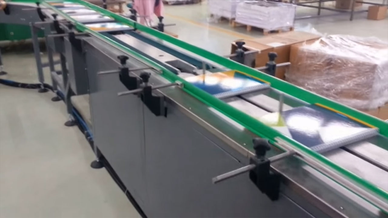 Impack Motion, Notebook Shrink Packaging Automation
