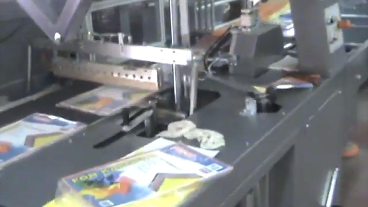 Impack Motion, Agrupamiento y Embalaje Retráctil de Pilas de Papeles y Revistas