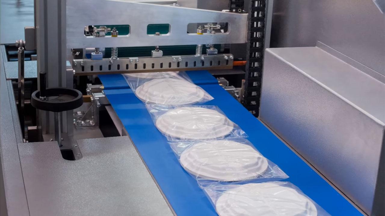 Wrapture 40 Pro-Motion, Embalagem retratil de pratos de plástico descartáveis